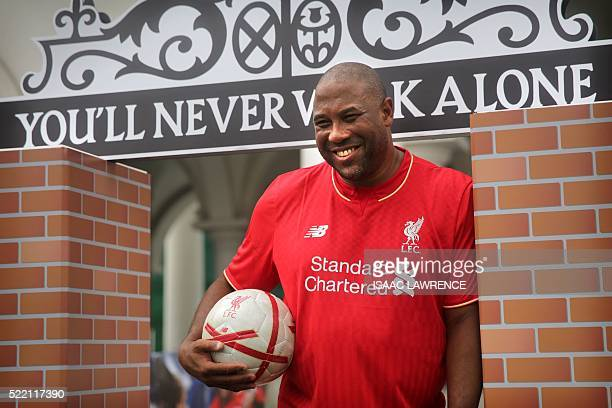 This picture taken on April 17, 2016 shows John Barnes, a former English and Liverpool football player, posing for photographs during a Liverpool FC...