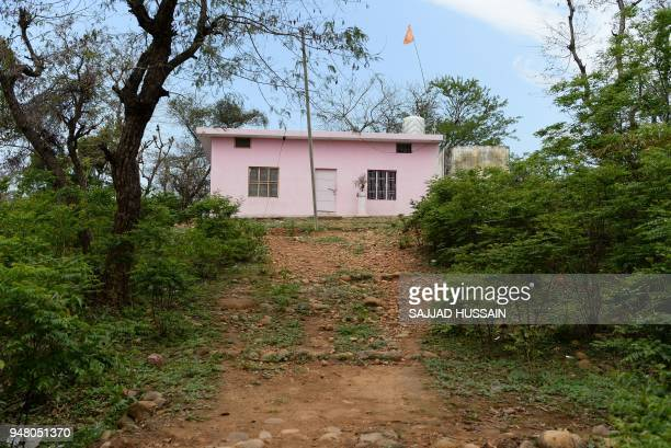 This picture taken on April 17 shows a path leading to view Devasthan Hindu temple where an eightyearold girl was raped and murdered at Rasana...