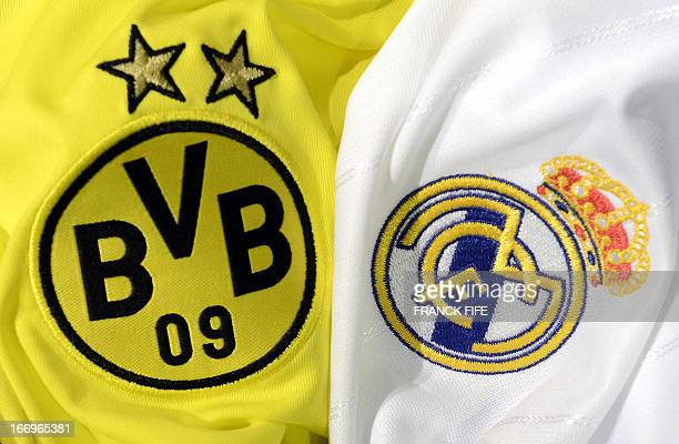 This picture taken on April 18, 2013 in Paris, shows the jerseys of the Borussia Dortmund and Real Madrid football clubs. Borussia Dortmund will play...