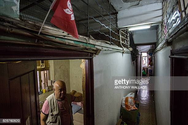 This picture taken on April 18 2016 shows Mr Chan standing under a miniature Hong Kong flag which he has displayed above the entrance of his...