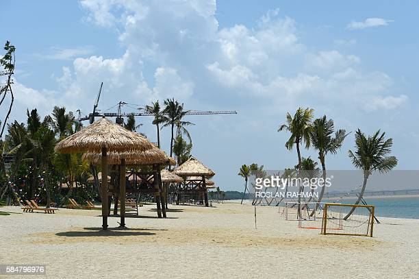 This picture taken on April 19 2016 shows a view along the beach at ForestCity on one of the manmade islands on the Malaysian side of the Straits of...
