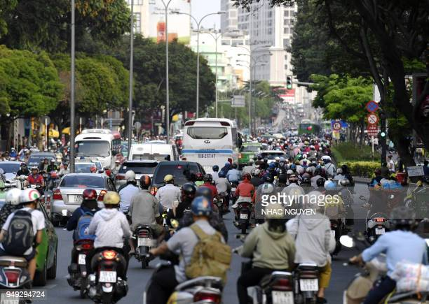 This picture taken on April 19 2018 shows a traffic along a crowded street in central Ho Chi Minh City In 2017 some 71 Vietnamese nationals were...