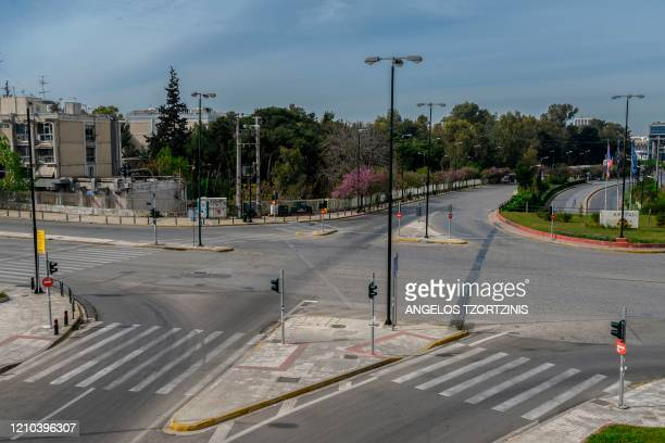 This picture taken on April 19 2020 shows an empty road during the Orthodox Easter in Athens during the COVID19 outbreak caused by the spread of the...