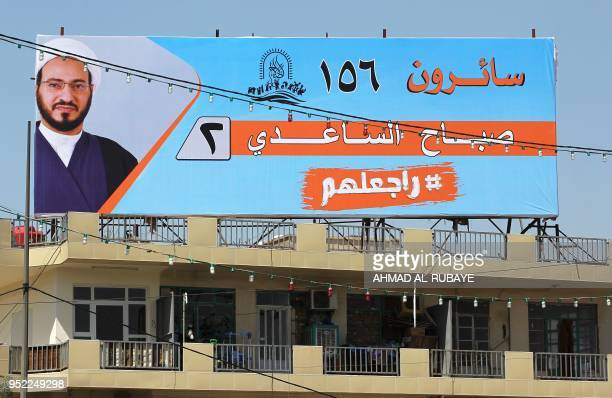 This picture taken on April 19 shows an electoral poster of the candidate Sabah Al Saadi ahead of the parliamentary elections to be held on May 12 in...