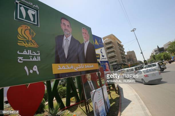 This picture taken on April 19 shows an electoral poster of the candidate Hadi alAmeri ahead of the parliamentary elections to be held on May 12 in...