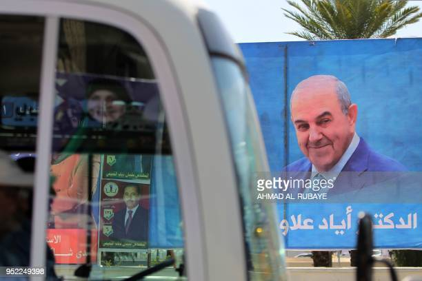 This picture taken on April 19 shows an electoral poster of the candidate Iyad Allawi ahead of the parliamentary elections to be held on May 12 in...