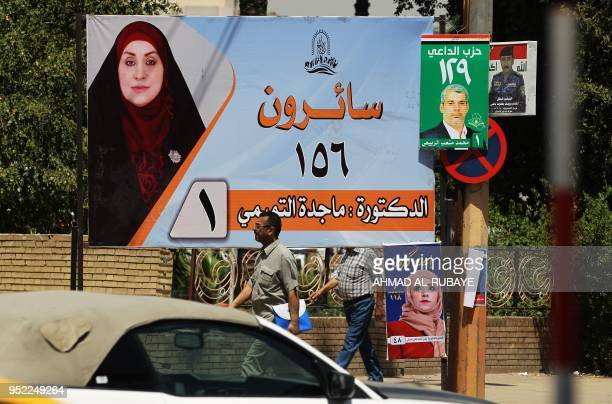 This picture taken on April 19 shows an electoral poster of the candidate Magda AlTamimi ahead of the parliamentary elections to be held on May 12 in...