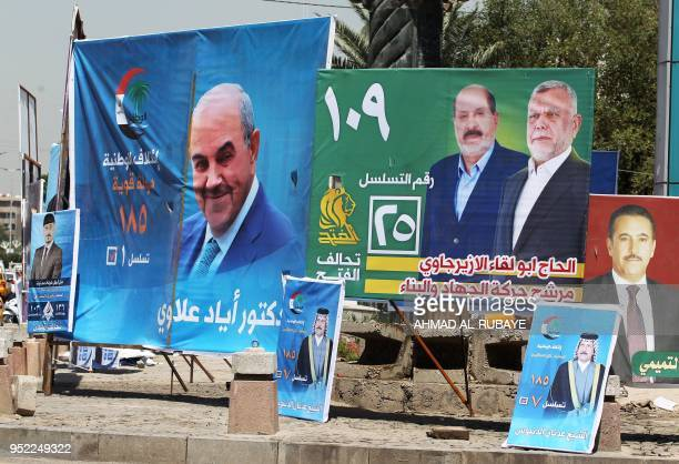 This picture taken on April 19 shows electoral posters ahead of the parliamentary elections to be held on May 12 in Baghdad Only a decade after...