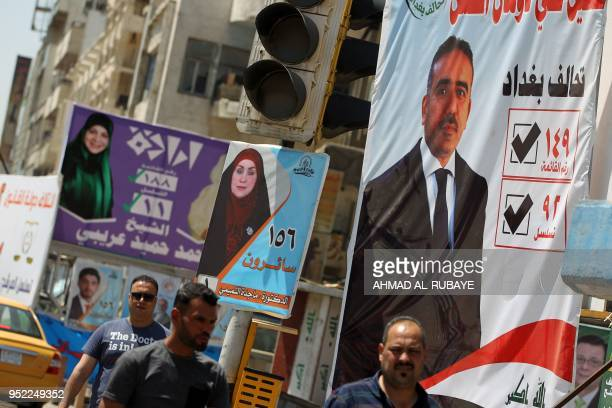 This picture taken on April 19 shows electoral posters of the candidate Magda AlTamimi and Hanan AlFatlawi ahead of the parliamentary elections to be...