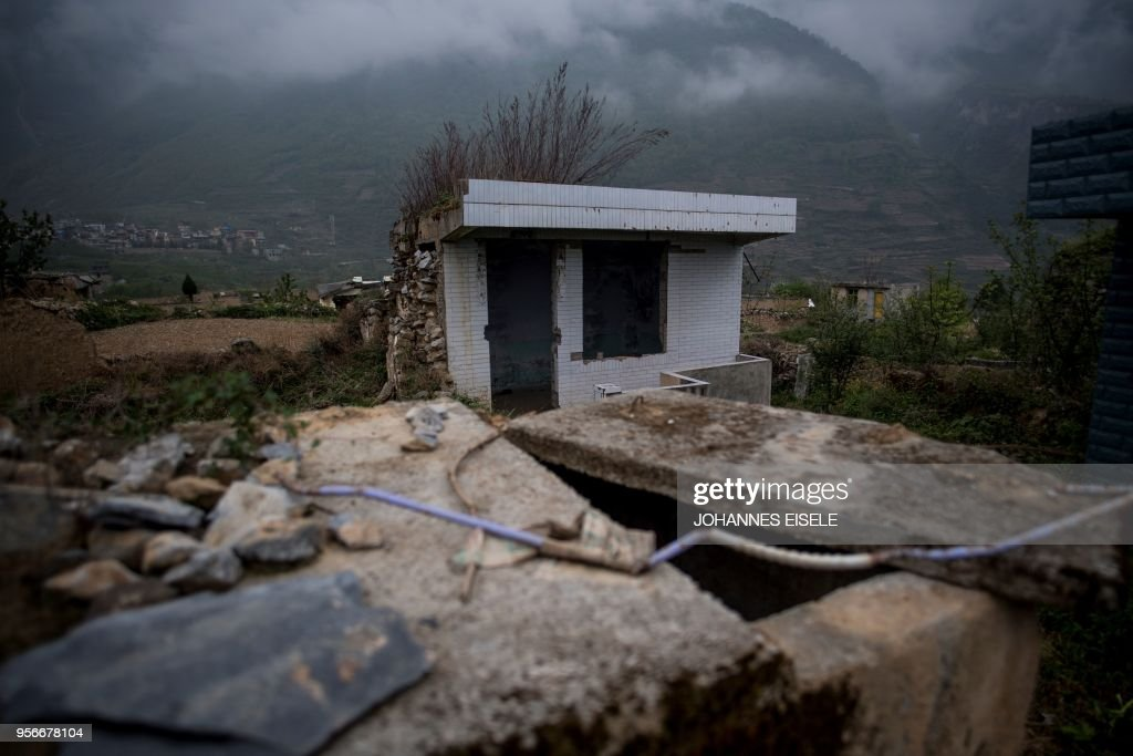This picture taken on April 21, 2018 shows a damaged house in the old village of Luobozhai (Radish Village), which was damaged during the 2008 Sichuan earthquake, in Wenchuan county, Sichuan province. - The village, on a small plateau near the top of a mountain, was badly damaged in the earthquake and most of the villagers moved to a new village nearby. China on May 12, 2018 will mark the 10-year anniversary of the quake which killed some 87,000 people across Sichuan province.