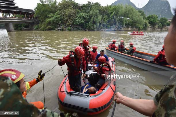 This picture taken on April 21 2018 shows rescuers returning to shore with victims of an accident involving two boats capsizing in Guilin in southern...