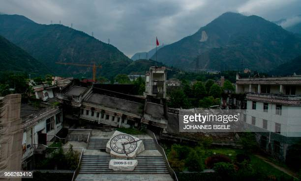 This picture taken on April 21 2018 shows the destroyed Xuankou Middle School the memorial site for the 2008 Sichuan earthquake in Yingxiu near...