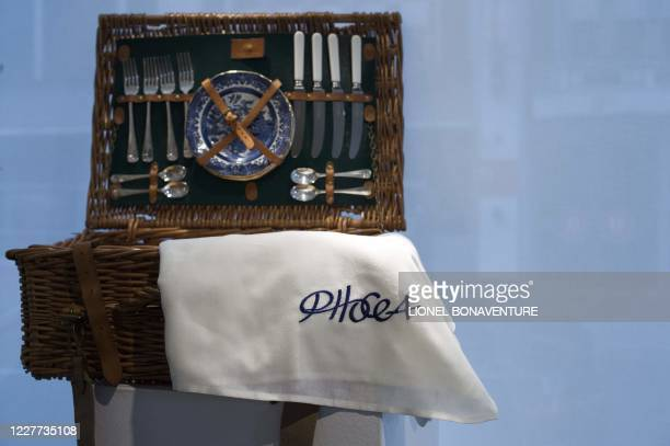 This picture taken on April 22, 2014 shows a picnic basket by Mulberry company at the hotel Drouot, where thousand of objects from the Phocea yatch,...
