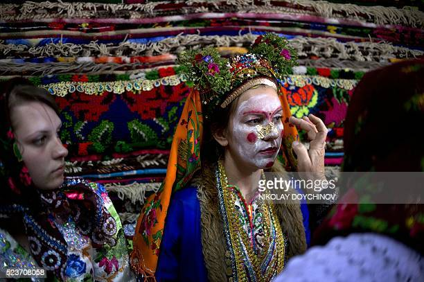 This picture taken on April 22 shows a Bulgarian Pomak bride Emilia Pechinkova 24yearsold as she goes through the gelina or face painting in...
