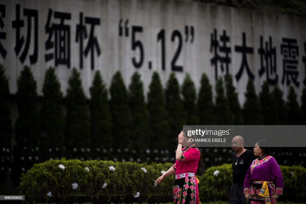 This picture taken on April 23, 2018 shows a memorial for victims of the 2008 Sichuan earthquake in Beichuan, Sichuan province. - The city of Beichuan has been kept frozen in time since May 12, 2008, when a 7.9-magnitude earthquake killed some 87,000 people across Sichuan province. (Photo by Johannes EISELE / AFP) / TO GO WITH China-quake-tourism,FOCUS by Ben Dooley