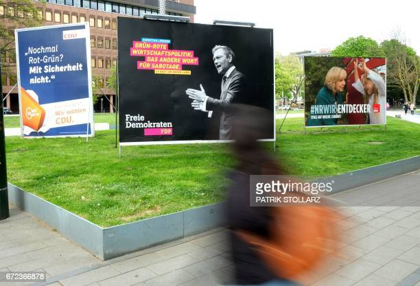 This picture taken on April 24 2017 in Duesseldorf shows electoral posters ahead of the May 14 local election in the NorthRhine Westfalia state / AFP...