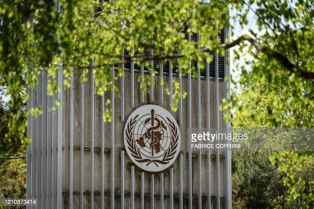 This picture taken on April 24, 2020 shows a sign of the World Health Organization in Geneva next to their headquarters, amid the COVID-19 outbreak,...