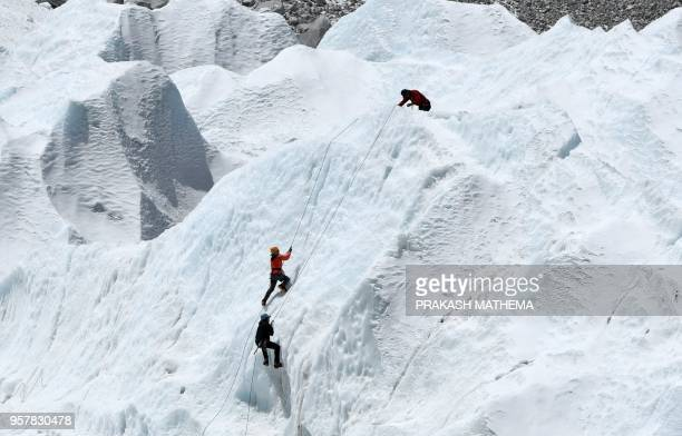 This picture taken on April 24 shows climbers at Everest Base Camp practicing their techniques on the Khumbu glacier before trying to summit Everest,...