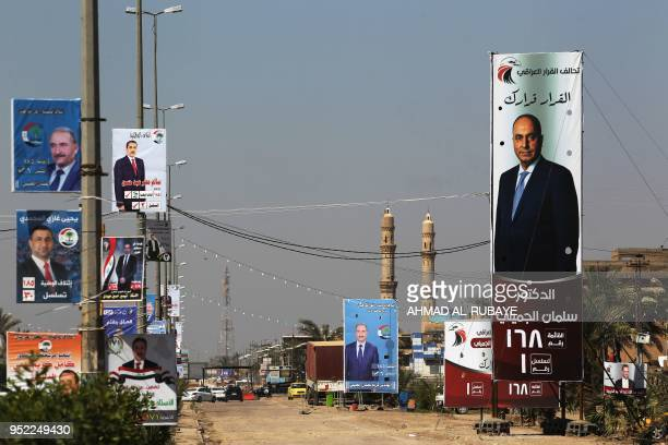 This picture taken on April 24 shows electoral posters ahead of the parliamentary elections to be held on May 12 in Fallujah Only a decade after...