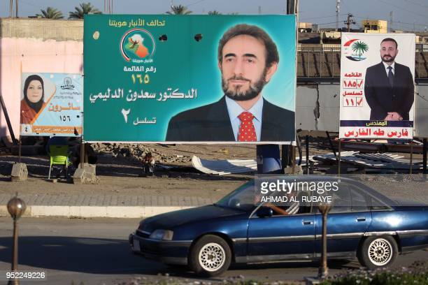 This picture taken on April 24 shows electoral posters of former defense minister Saadoun alDulaimi ahead of the parliamentary elections to be held...