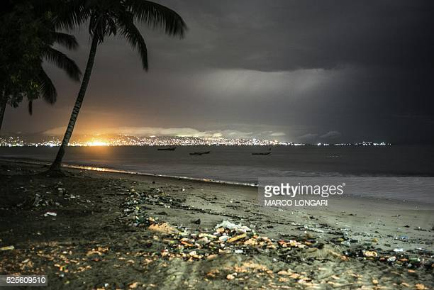 This picture taken on April 24 shows the skyline of Freetown from the beach from where the ferries linking the airport to the Sierra Leone capital...
