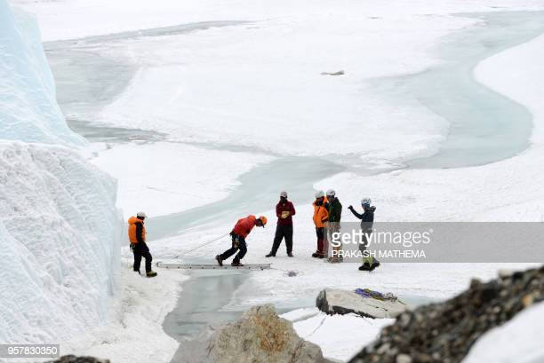 This picture taken on April 25 shows climbers at Everest Base Camp practicing their techniques on the Khumbu glacier before trying to summit Everest...