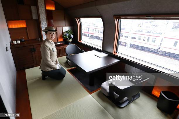 This picture taken on April 26 2017 shows a crew member introducing the ShikiShima Suite of the Train Suite ShikiShima operated by East Japan Railway...