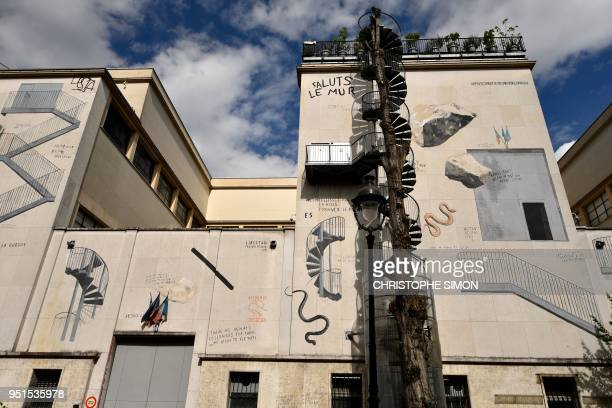 This picture taken on April 26 2018 in Paris shows a mural painted by Spanish artist Escif on the facade of the modern and contemporary art museum...