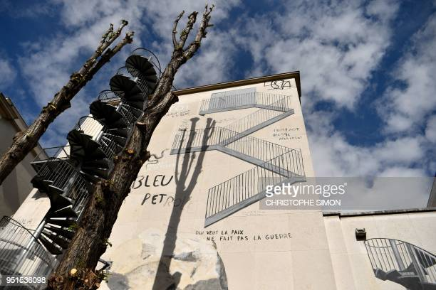 TOPSHOT This picture taken on April 26 2018 in Paris shows a mural painted by Spanish artist Escif on the facade of the modern and contemporary art...