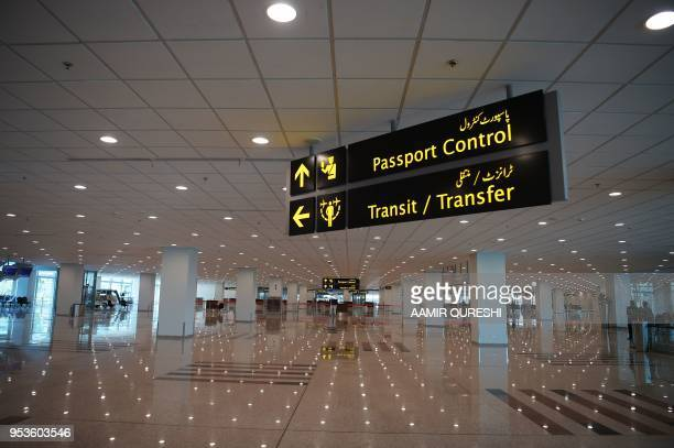 This picture taken on April 26 2018 shows a general view of the international arrivals area of the newly built Islamabad International Airport ahead...