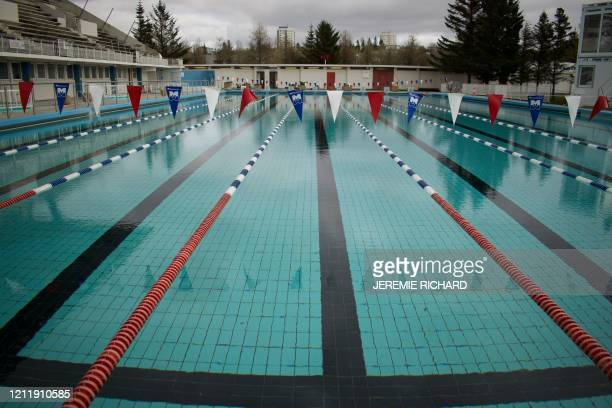 This picture taken on April 27, 2020 shows a view of the 50m outdoor pool at the biggest swimming pool of Iceland, Laugardalslaug, closed du to the...