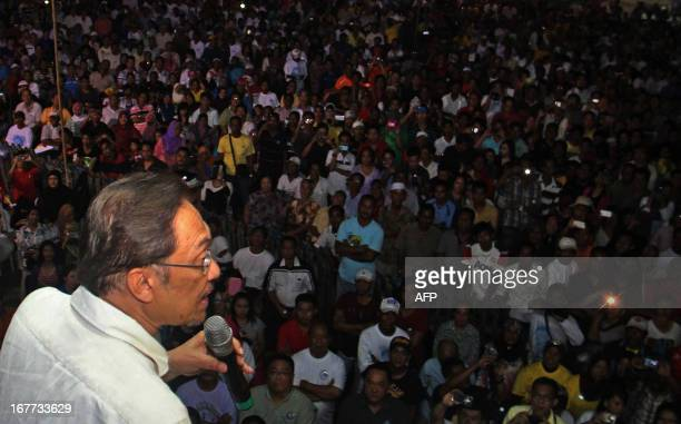 This picture taken on April 28, 2013 shows Malaysia's opposition leader Anwar Ibrahim addressing supporters during a campaign event ahead of the...