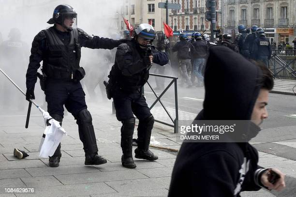 TOPSHOT This picture taken on April 28 2016 shows riot police using a LBD40 gun and aiming at a young protester during a demonstration against the...