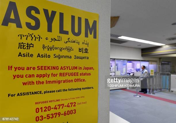 This picture taken on April 28 2017 shows a poster near the passport control counter of the immigration office at the Narita International airport in...