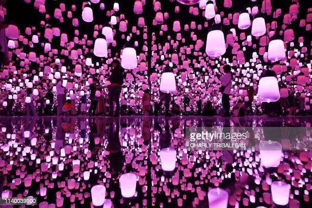 TOPSHOT This picture taken on April 28 2019 shows people enjoying their visit at the team lab borderless museum of Tokyo Collective teamLab known...