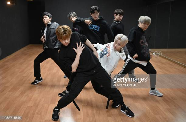 This picture taken on April 29, 2021 shows members of the K-pop boy band Blitzers performing during their dance practise session at a rehearsal...