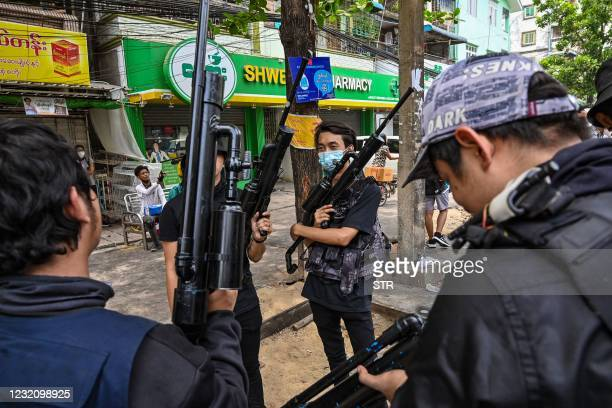 This picture taken on April 3, 2021 shows protesters holding homemade weapons during a demonstration against the military coup in Yangon's Tamwe...