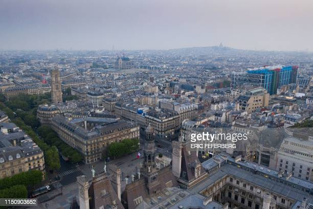 This picture taken on April 30, 2019 in Paris shows an aerial view of the Hotel de Ville , the Saint-Jacques Tower , the Pompidou Centre and the...