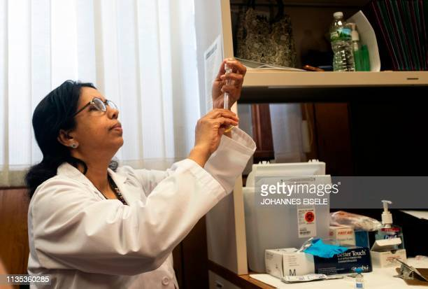 This picture taken on April 5 2019 shows a nurse preparing the measles mumps and rubella vaccine at the Rockland County Health Department in...