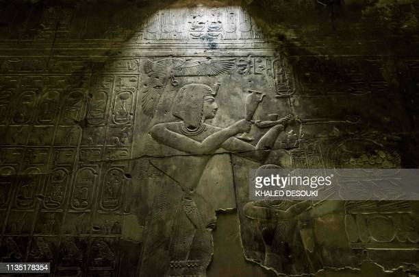 This picture taken on April 5 2019 shows a view of hieroglyphic inscriptions and relief on a wall of the the New Kingdom period Temple of Seti I at...