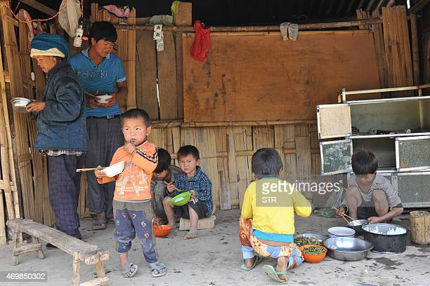 This picture taken on April 6 2015 shows Kokang refugees having a meal at their temporary shelter in the border area of China and Myanmar in Nansan...