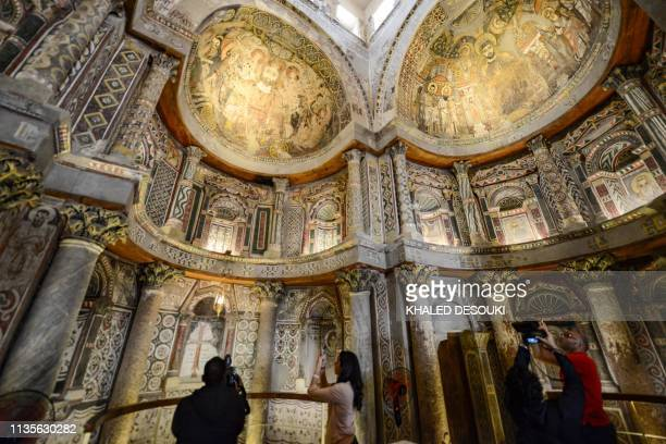 This picture taken on April 6 2019 shows a view inside the basilica of the Coptic Orthodox Red Monastery of St Pishay in Egypt's southern Sohag...