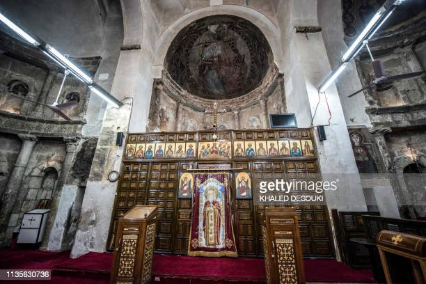 """This picture taken on April 6, 2019 shows a view of the nave of the basilica of the Coptic Orthodox """"White Monastery"""" of St Shenouda the..."""
