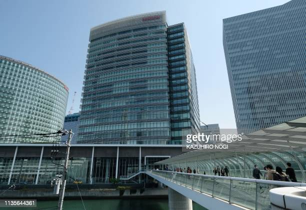This picture taken on April 6, 2019 shows the building of the Nissan Motor Corporation headquarters in Yokohama. - Nissan shareholders are expected...