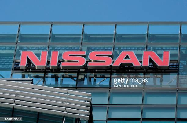 This picture taken on April 6 2019 shows the logo of Japan's Nissan Motor Corporation displayed at its headquarters in Yokohama Nissan shareholders...