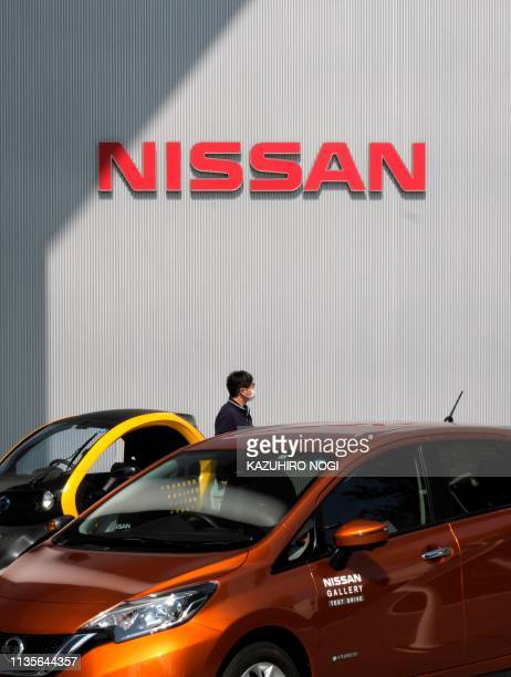 This picture taken on April 6, 2019 shows the logo of Japan's Nissan Motor Corporation displayed at its headquarters in Yokohama. - Nissan...