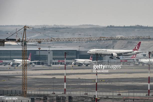 This picture taken on April 6 2019 shows Turkish airlines planes parked at the new Istanbul Airport on the first day after it moved from Ataturk...