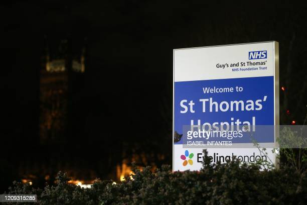 This picture taken on April 6 shows a the sign at the entrance of St Thomas' Hospital in London British Prime Minister who was diagnosed with...