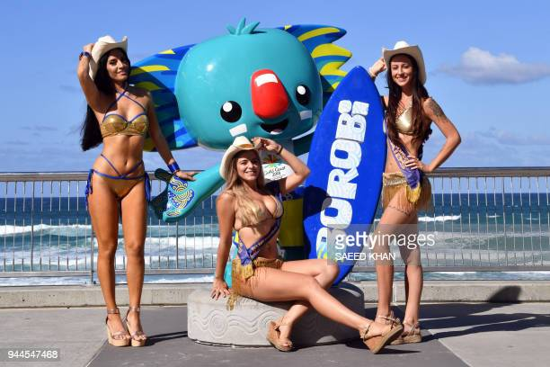 This picture taken on April 7 2018 shows meter maids posing with the Commonwealth Games Mascot at Surfers Paradise on Gold Coast The Gold Coast's...