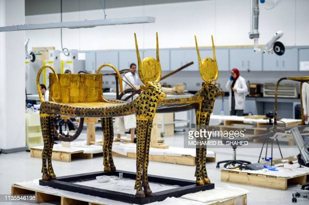 This picture taken on April 7 2019 shows a view of one of the artefacts of the Tutankhamun collection currently undergoing work at the restoration...